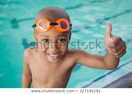 Mały chłopca basen uśmiechnięty szczęśliwy Zdjęcia stock © galitskaya