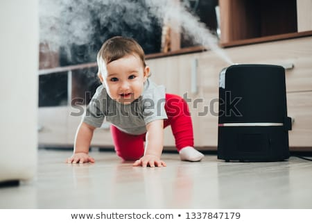 Little baby looks at the humidifier Stock photo © galitskaya