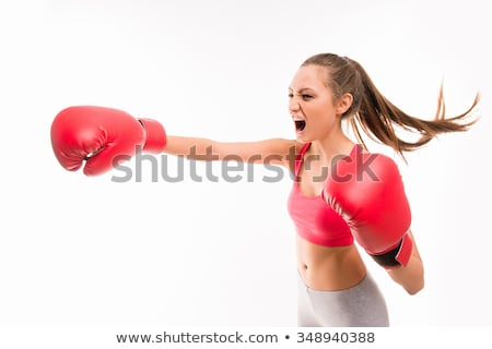 On a white background sportswoman beats kicking Stock photo © Andreyfire