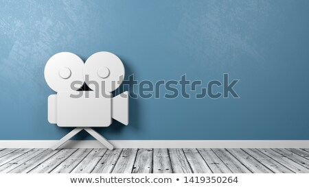 Old Video Camera Symbol on Wooden Floor Against Wall Stock photo © make