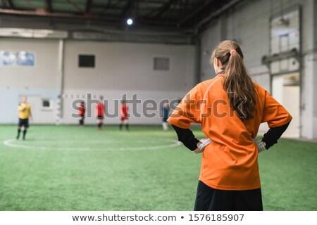 Hátulnézet fiatal női kapus sportok egyenruha Stock fotó © pressmaster
