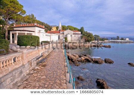Adriatic town of Opatija watefront walkway and church view Stock photo © xbrchx