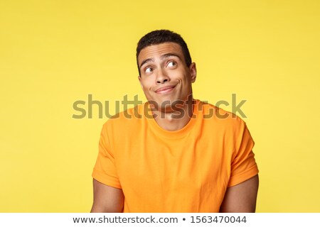 Unsure, careless and unbothered handsome brazilian guy in casual t-shirt, shrugging indecisive, look Stock photo © benzoix