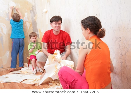 family makes interruption in  removal of    wallpapers from wall Stock photo © Paha_L