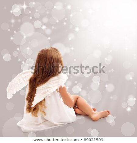 Pequeno anjo pensando divino luz menina Foto stock © ilona75