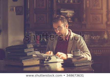 Young man writing in a book Stock photo © photography33