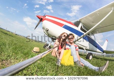 Pareja embarque luz aeronaves avión avión Foto stock © photography33