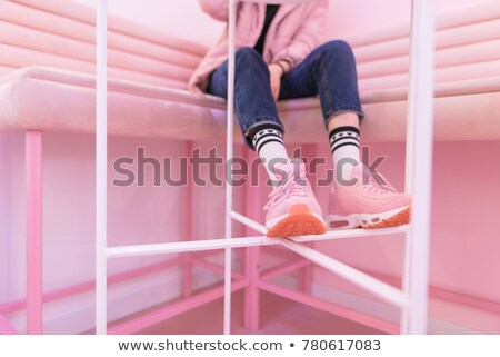 Pink sneakers on girl, woman legs Stock photo © photocreo