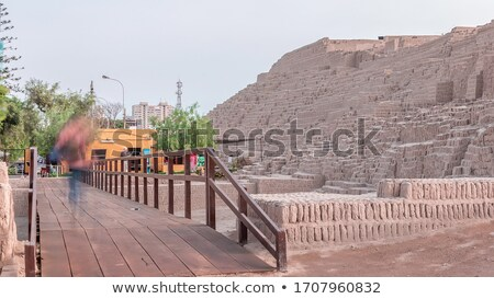 brick footbridge to green hill stock photo © ansonstock