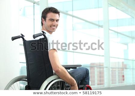 upośledzony · biznesmen · posiedzenia · wózek · portret · biuro - zdjęcia stock © photography33