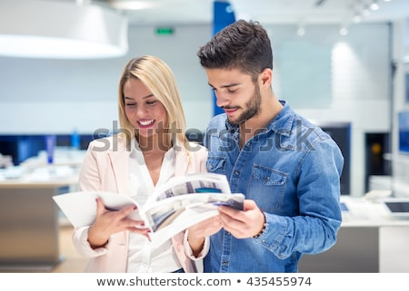 Couple looking at a catalogue Stock photo © photography33
