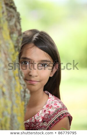 A little Latina hiding behind a tree. Stock photo © photography33