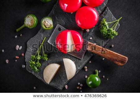 Round wax covered dutch edam gouda cheese Stock photo © backyardproductions