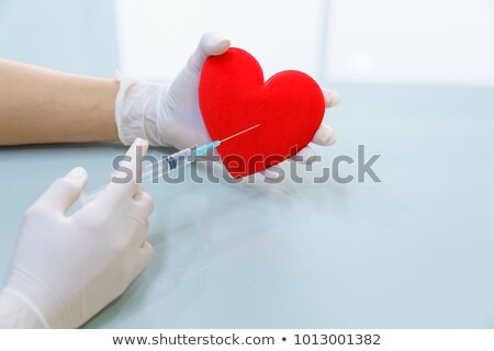 Stock photo: Syringe and Red Heart