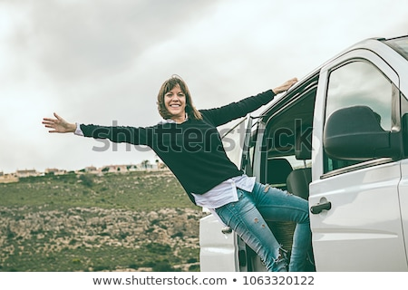 Young woman leaning out of car window Stock photo © photography33