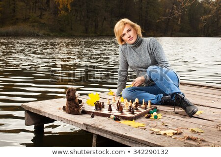 Cute blond girl playing chess stock photo © photography33