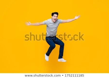счастливым · прыжки · изолированный · белый · рук - Сток-фото © Melpomene