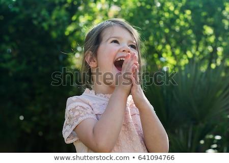 Küçük kız utangaç gülümseme bahçıvanlık çiçek bahar Stok fotoğraf © photography33