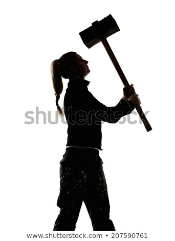 Female construction worker holding a sledgehammer. Stock photo © photography33