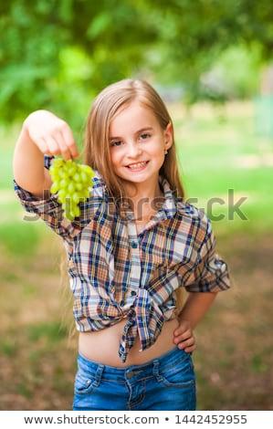 woman holding a grape Stock photo © photography33