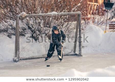 Little boy playing ice hockey stock photo © bigjohn36