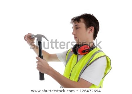 Teen apprentice with hammer and nail Stock photo © lovleah