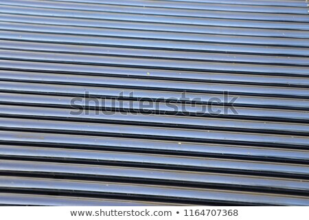 Solar hot water glass tube panel array closeup Stock photo © Rob300