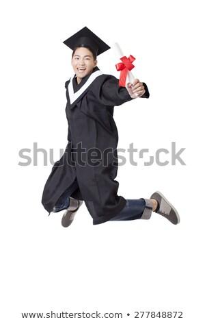 Masculino estudante pós-graduação robe saltando branco Foto stock © wavebreak_media