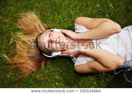 Nő fektet fű fejhallgató zöld fű nők Stock fotó © chesterf