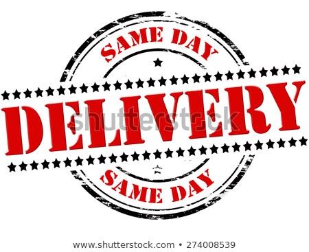 Same Day Delivery on Red Rubber Stamp. Stock photo © tashatuvango