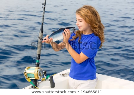 Blond girl fishing bluefin tuna trolling in Mediterranean Stock photo © lunamarina