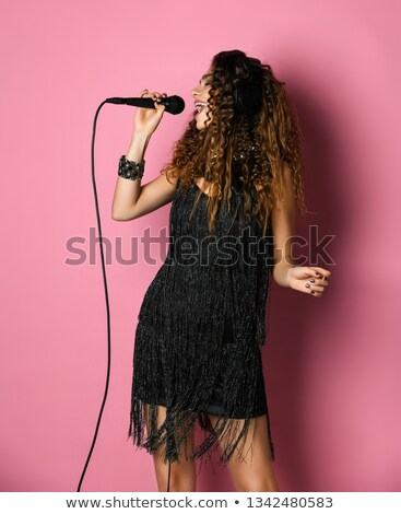 Hermosa cantante micrófono aumentó moda labios Foto stock © Nejron