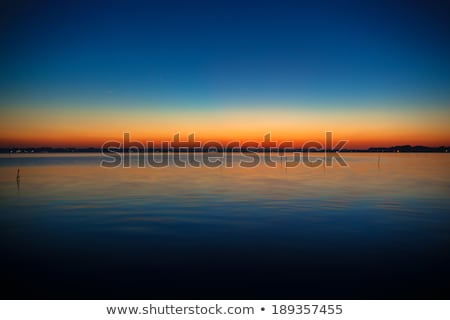 Blue and orange gradation of sunset on the lake Kasumigaura Stock photo © shihina