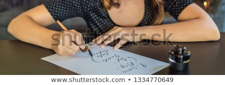 Attractive lady with an ancinet dokument Stock photo © Nejron