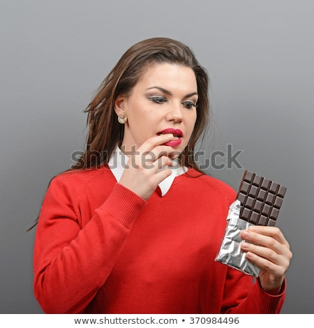 Beautiful girl with a chocolate craving close-up portrait Stock photo © Nejron
