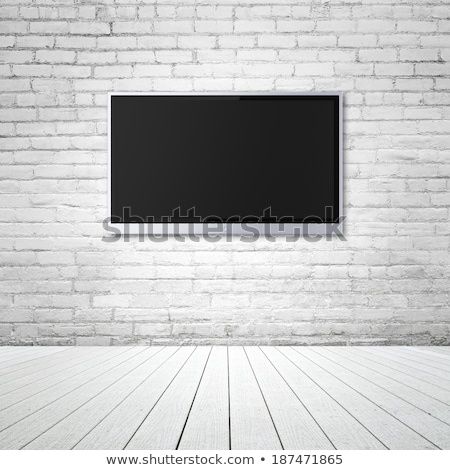 TV display on brick wall Stock photo © karandaev