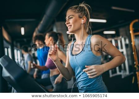 Ejecutando gimnasio saludable hombre mujer noria Foto stock © Hofmeester