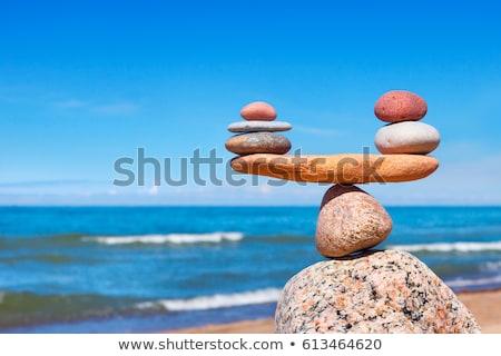 Balanced stones, pebbles stacks against blue sea.   Stock photo © EwaStudio