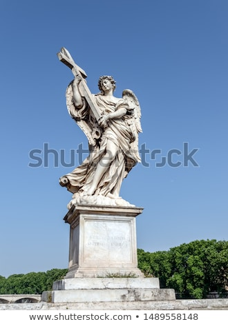 berninis marble statue of angel with cross from the santangelo bridge in rome stock photo © dserra1