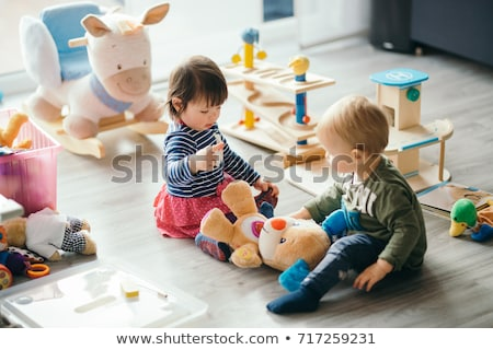 baba · játékok · egyéves · fiú · játszik · stúdiófelvétel - stock fotó © nyul