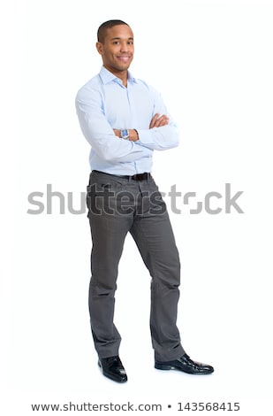 portrait of a happy african man standing with arms folded over white background stock photo © deandrobot