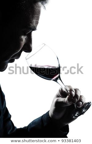 businessman holding glass of wine stock photo © nyul
