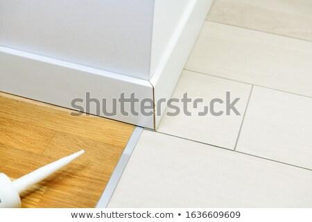 Installing ceramic flooring - fitting a tile stock photo © lightkeeper