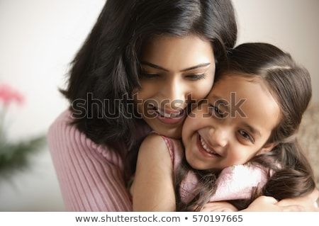 close up of happy mother and daughter with camera stock photo © dolgachov