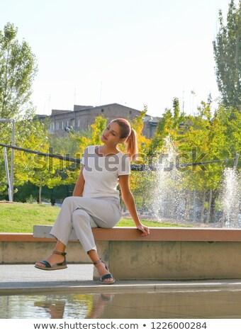 aantrekkelijk · meisje · vergadering · fontein · meisje · roze · jurk - stockfoto © konradbak