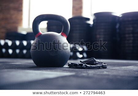 Kettle ball and sports gloves Stock photo © deandrobot