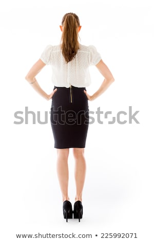 Rear view of businesswoman with hands on hips Stock photo © wavebreak_media