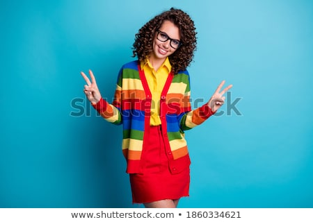 hands showing peace sign over rainbow stripes Stock photo © dolgachov