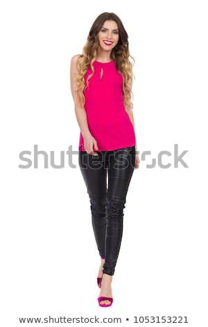 gyönyörű · lány · fekete · bőr · nadrág · izolált · fehér - stock fotó © elnur