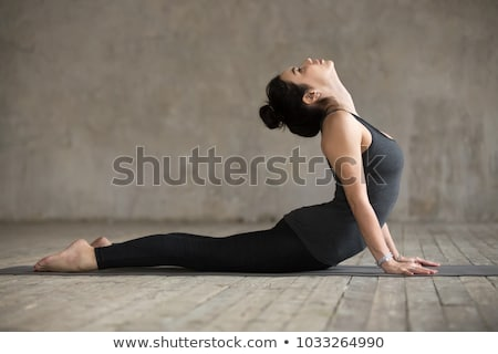Pilates woman snake exercise workout at gym Stock photo © lunamarina